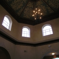 Large painted dome, glazed walls, detailed moldings and trompe l'oeil relief.
