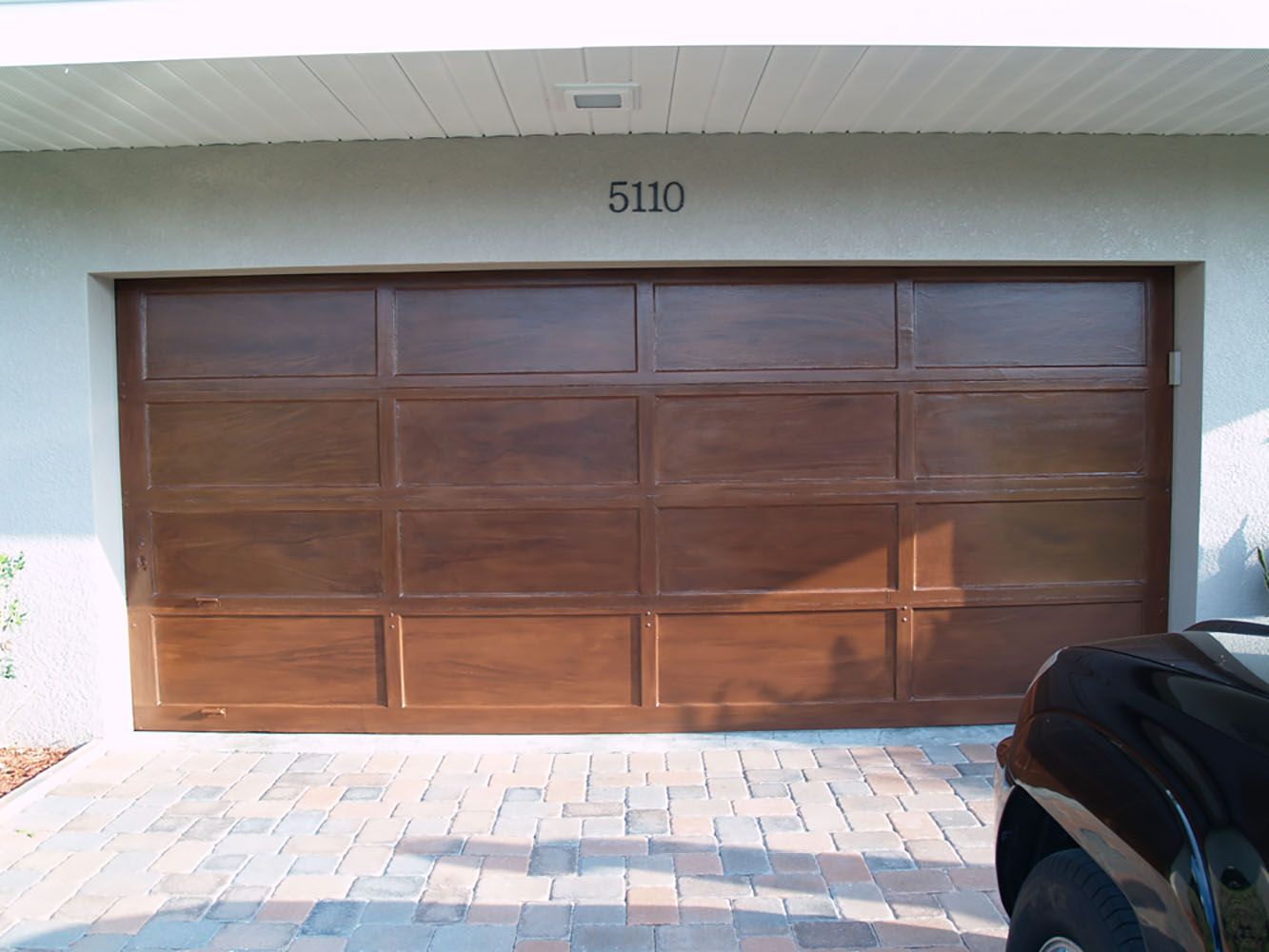 Splatpaint tampa custom artistic finishes and murals Garage door faux wood